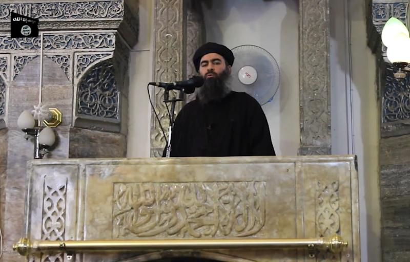 This image grab taken from a propaganda video released on July 5, 2014 allegedly shows Baghdadi addressing Muslim worshippers at a mosque in Mosul (AFP Photo/-)