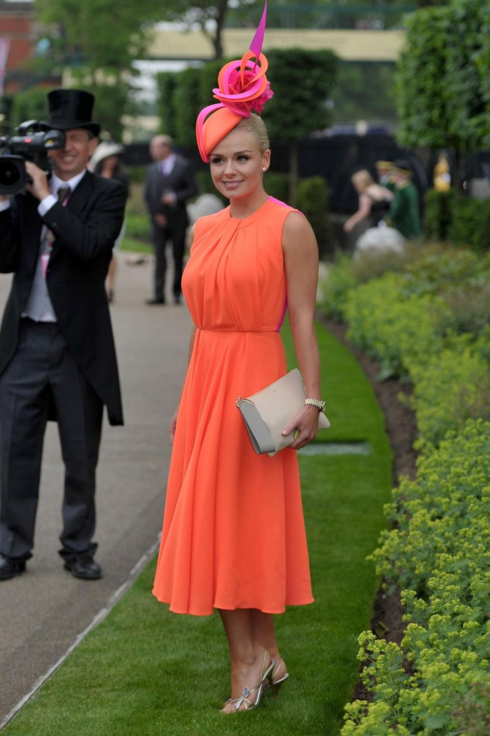 <p>In 2013, the opera singer kept all eyes on her in a neon orange dress.<br><i>[Photo: PA]</i> </p>