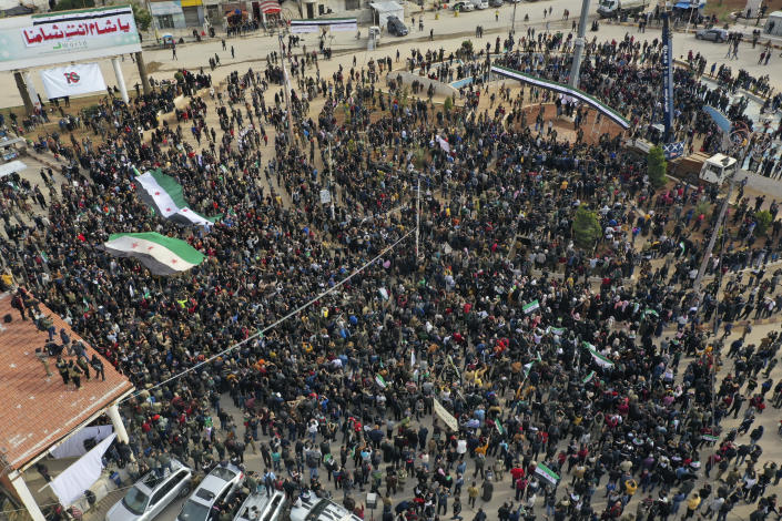 Thousands of anti-Syrian government protesters mark 10 years since the start of a popular uprising against President Bashar Assad's rule, that later turned into an insurgency and civil war, In Idlib, the last major opposition-held area of the country, in northwest Syria, Monday, March 15, 2021. (AP Photo/Ghaith Alsayed)