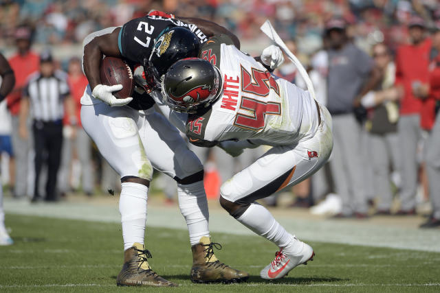 Tampa Bay Buccaneers linebacker Devin White (45) brings down Jacksonville Jaguars running back Leonard Fournette (27) during the second half of an NFL football game, Sunday, Dec. 1, 2019, in Jacksonville, Fla. (AP Photo/Phelan M. Ebenhack)