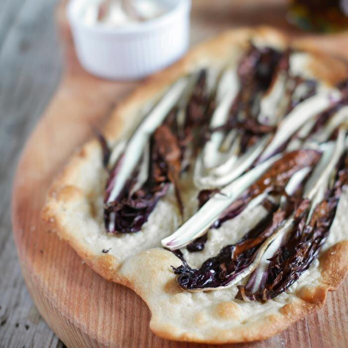 """<p><a href=""""https://www.shape.com/healthy-eating/diet-tips/benefits-fiber-make-it-most-important-nutrient-your-diet"""" target=""""_blank"""">Fiber-rich</a> leafy vegetables are a great way to bulk up a healthy sandwich. </p> <p><strong>Healthy Sandwich Calorie Count:</strong> 243</p> <p>Sauté sliced radicchio with a teaspoon of olive oil and minced garlic until wilted (about 5 minutes). In the toaster, melt 1/4 cup shredded nonfat mozzarella on a slice of whole grain bread, then top with the radicchio. </p>"""