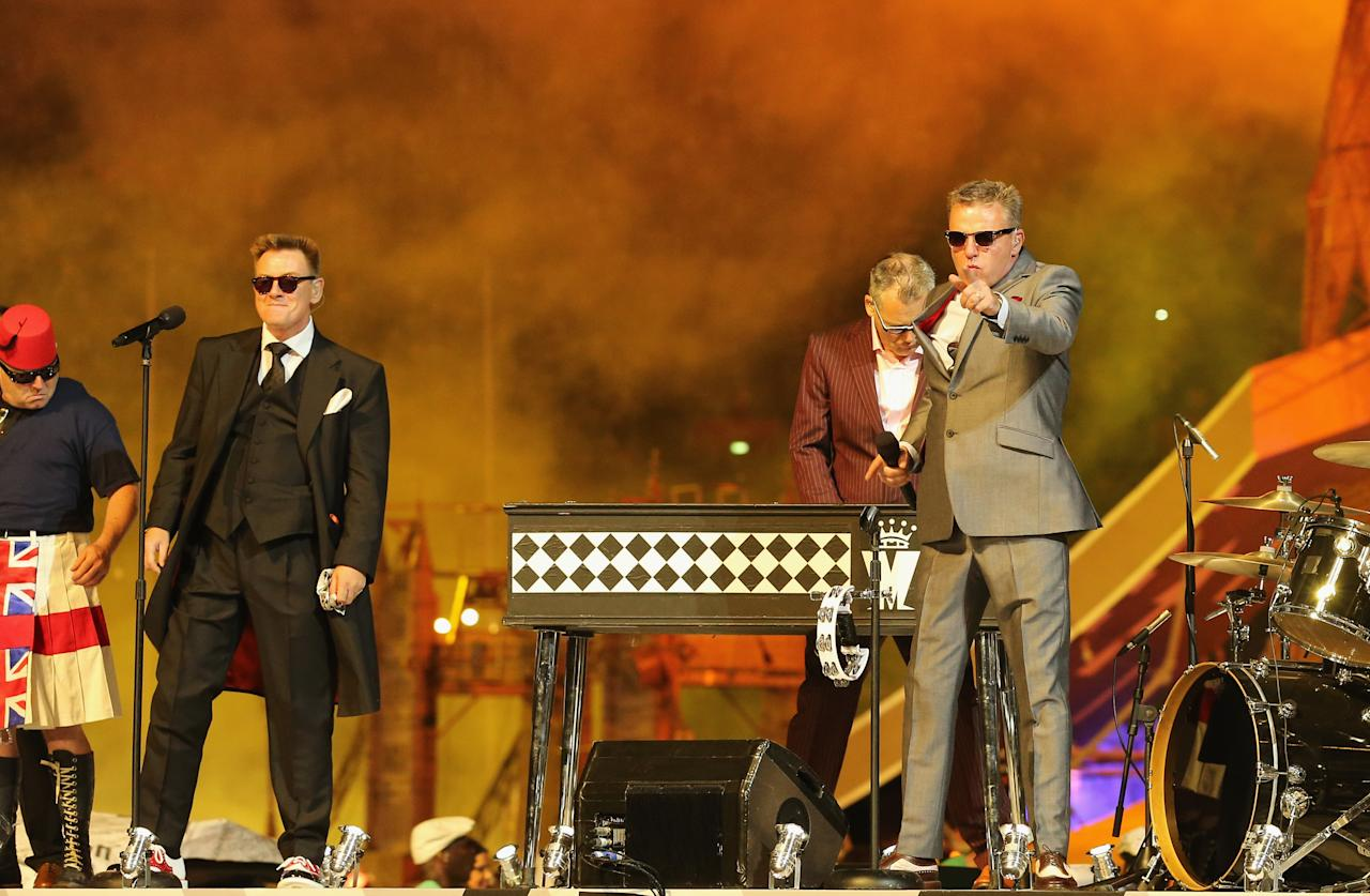 LONDON, ENGLAND - AUGUST 12:  Chas Smash and Lead singer Graham ?Suggs? McPherson of Madness during the Closing Ceremony on Day 16 of the London 2012 Olympic Games at Olympic Stadium on August 12, 2012 in London, England.  (Photo by Scott Heavey/Getty Images)