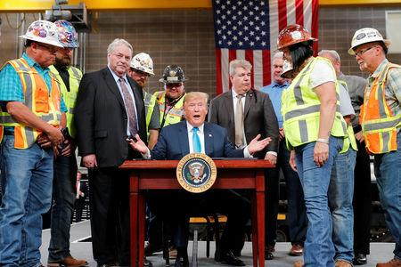 U.S. President Donald Trump speaks as he signs an executive order on energy and infrastructure during a campaign event at the International Union of Operating Engineers International Training and Education Center in Crosby, Texas, U.S., April 10, 2019. REUTERS/Carlos Barria