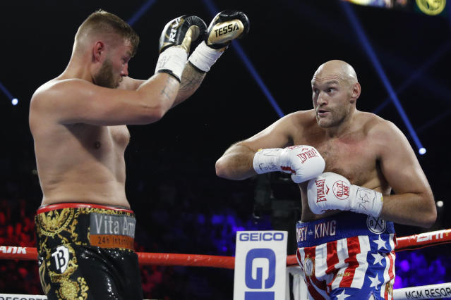 Tyson Fury, of England, right, and Tom Schwarz, of Germany, fight during a heavyweight boxing match Saturday, June 15, 2019, in Las Vegas. (AP Photo/John Locher)