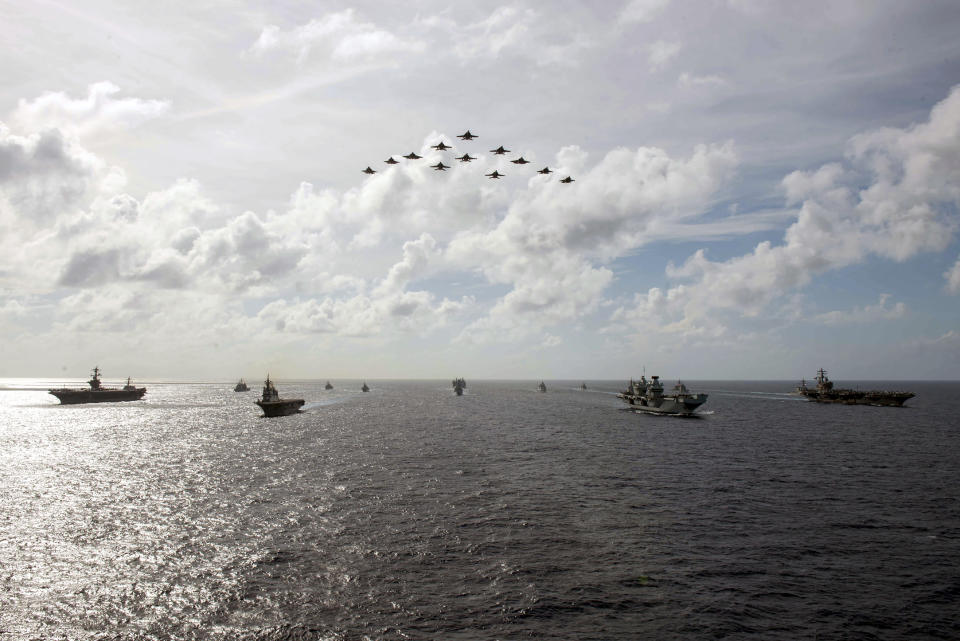 In this photo released by the U.S. Indo-Pacific Command, the United Kingdom's carrier strike group led by HMS Queen Elizabeth (R 08), and Japan Maritime Self-Defense Forces led by (JMSDF) Hyuga-class helicopter destroyer JS Ise (DDH 182) joined with U.S. Navy carrier strike groups led by flagships USS Ronald Reagan (CVN 76) and USS Carl Vinson (CVN 70) to conduct multiple carrier strike group operations in the Philippine Sea, on OCt. 3, 2021. After sending a record number of military aircraft to harass Taiwan over China's National Day holiday weekend, Beijing has toned down the sabre rattling but tensions remain high, with the rhetoric and reasoning behind the exercises unchanged. (Michael Jarmiolowski/U.S. Navy via AP)