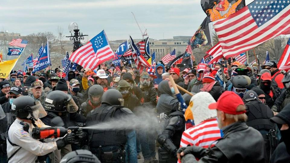 Trump supporters clash with police and security forces as people try to storm the US Capitol Building in Washington, DC, on January 6, 2021