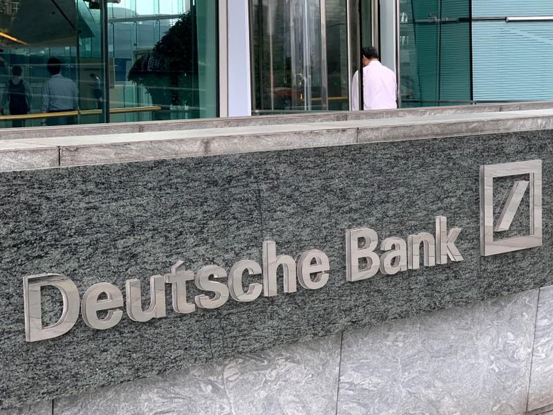 FILE PHOTO: The logo of Deutsche bank is seen in Hong Kong