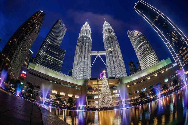 Join thousands of spectators at KLCC Park in Kuala Lumpur to countdown to 2020 against the iconic Petronas Twin Towers. ― Picture by Hari Anggara