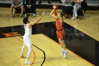 Oklahoma State guard Cade Cunningham, left, defends against a shot by Texas Tech guard Mac McClung, right, during an NCAA college basketball game Monday, Feb. 22, 2021, in Stillwater, Okla. (AP Photo/Brody Schmidt)