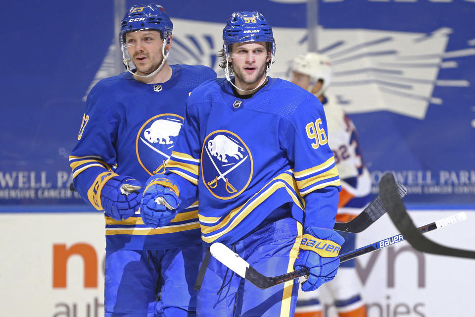 Buffalo Sabres forward Anders Bjork (96) celebrates his goal with forward Sam Reinhart (23) during the third period of an NHL hockey game against the New York Islanders, Tuesday, May 4, 2021, in Buffalo, N.Y. (AP Photo/Jeffrey T. Barnes)