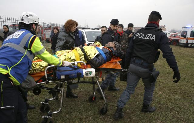 <p>An injured passenger is assisted after a train derailed at the station of Pioltello Limito, on the outskirts of Milan, Italy, Thursday, Jan. 25, 2018. (Photo: Luca Bruno/AP) </p>