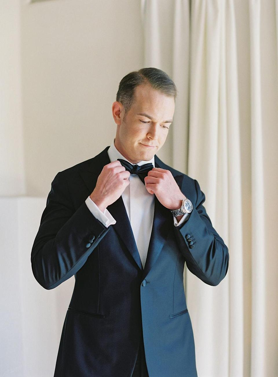 "<p>John went with a black peak lapel tuxedo paired with a silk bow tie. He finished his big-day look with leather shoes and <a href=""https://www.ferragamo.com/"" rel=""nofollow noopener"" target=""_blank"" data-ylk=""slk:Salvatore Ferragamo"" class=""link rapid-noclick-resp"">Salvatore Ferragamo</a> cuff links—a wedding gift from his bride.</p>"