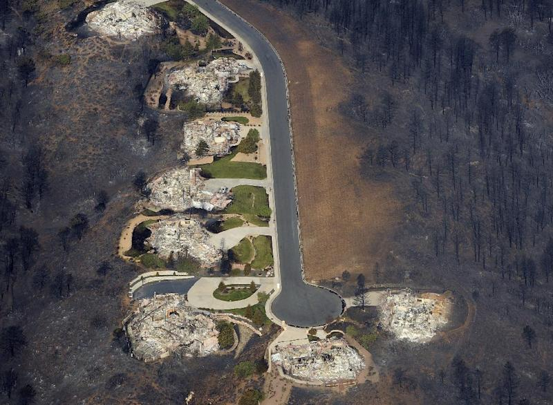 This aerial photo shows the destructive path of the Waldo Canyon fire in the Mountain Shadows subdivision area of Colorado Springs, Colo., Thursday, June 28, 2012. Colorado Springs officials  said Thursday that hundreds of homes have been destroyed by the raging wildfire. (AP Photo/Denver Post, RJ Sangosti)