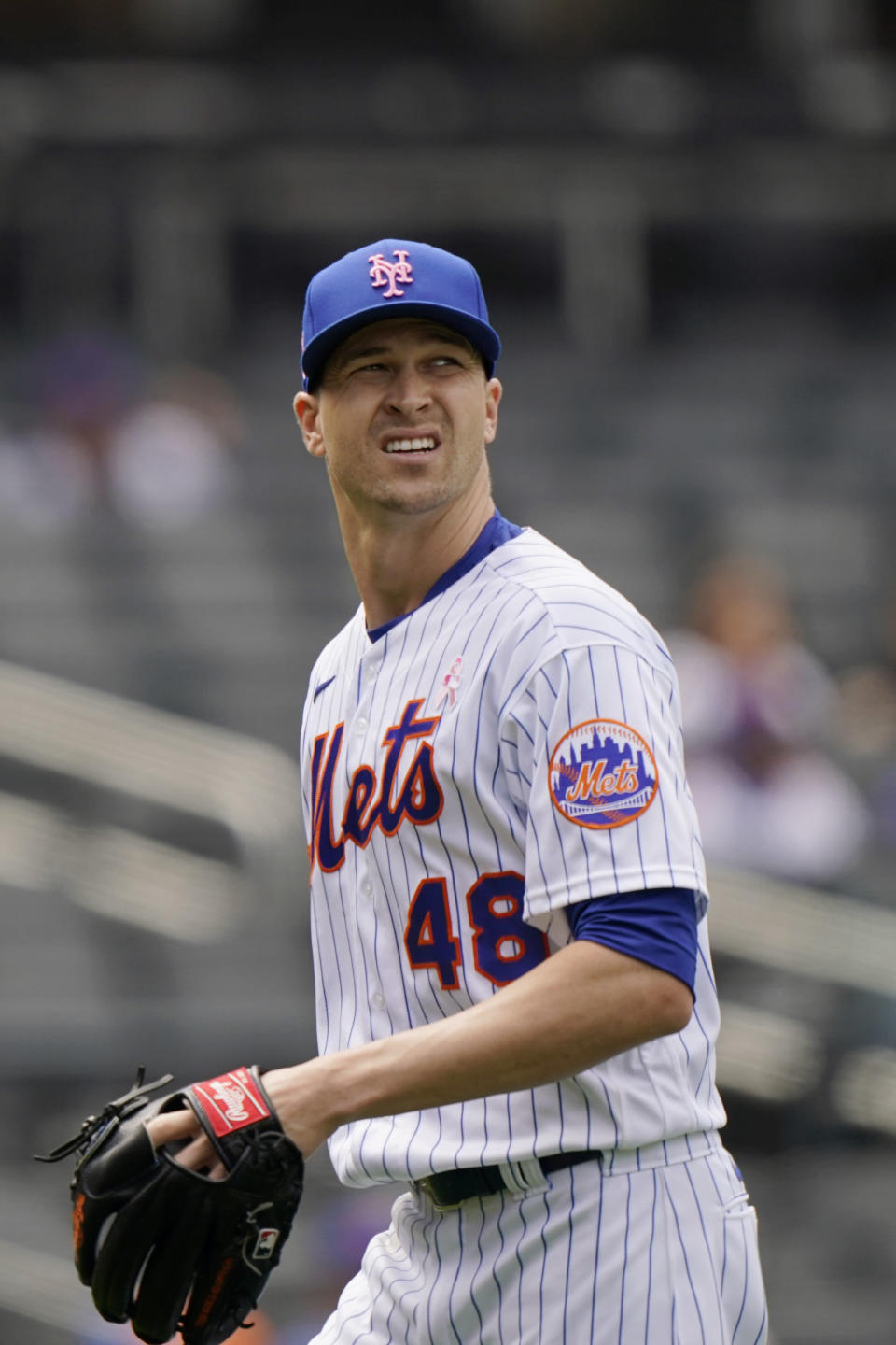 New York Mets starting pitcher Jacob deGrom leaves the field against the Arizona Diamondbacks, Sunday, May 9, 2021, in New York. deGrom left the game in the sixth inning after throwing only two warmup pitches. (AP Photo/Kathy Willens)