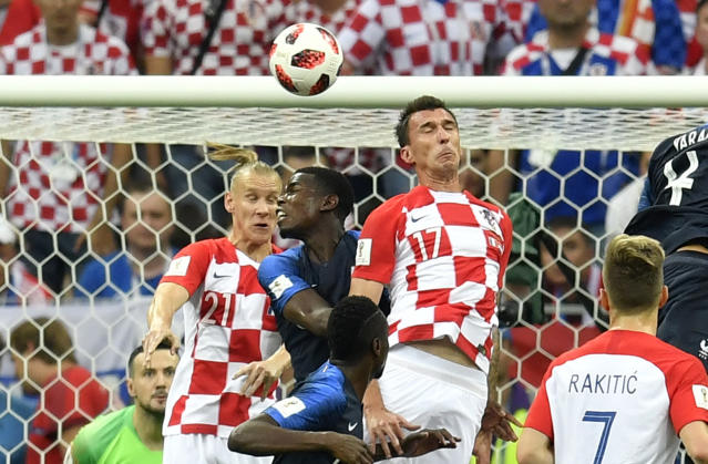 Croatia's Mario Mandzukic, 17, scores an own goal to give France the opening goal during the final match between France and Croatia at the 2018 soccer World Cup in the Luzhniki Stadium in Moscow, Russia, Sunday, July 15, 2018. (AP Photo/Martin Meissner)
