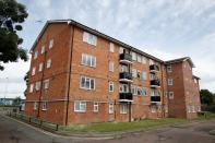 General view shows a block of flats where suspect was earlier apprehended following reported multiple stabbings in Reading