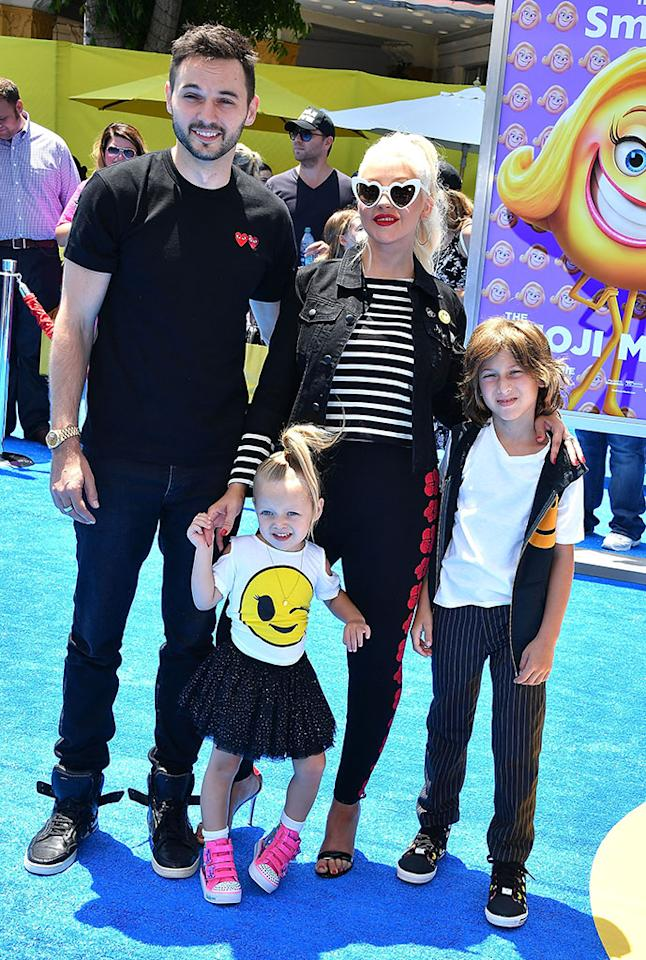<p>First family red carpet! Christina Aguilera, who voices Akiko Glitter in the movie, brought along her whole crew to Regency Village Theatre in L.A. on July 23 — and they were appropriately attired. The songstress wore heart-shaped glasses and pants with the flower emoji while her partner, Matthew Rutler, had hearts on his black shirt. The kids stole the show though with Summer giving a wink and Max a smiley face. (Photo: Steve Granitz/WireImage) </p>