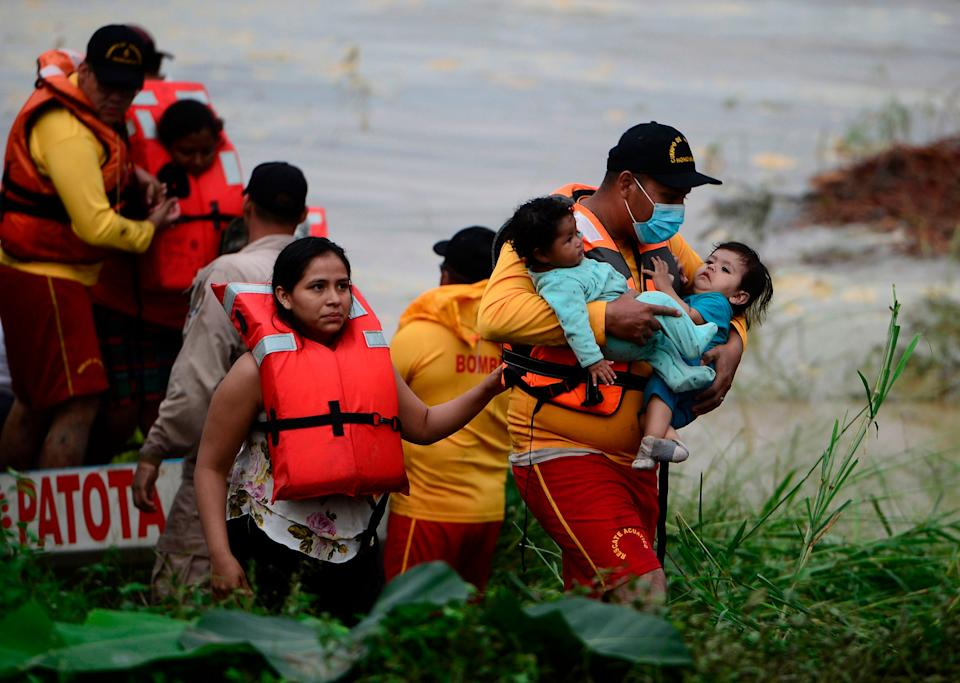 <p>Families are rescued amid flooding and landslides after Hurricane Eta struck in Honduras last month</p>AFP/Getty