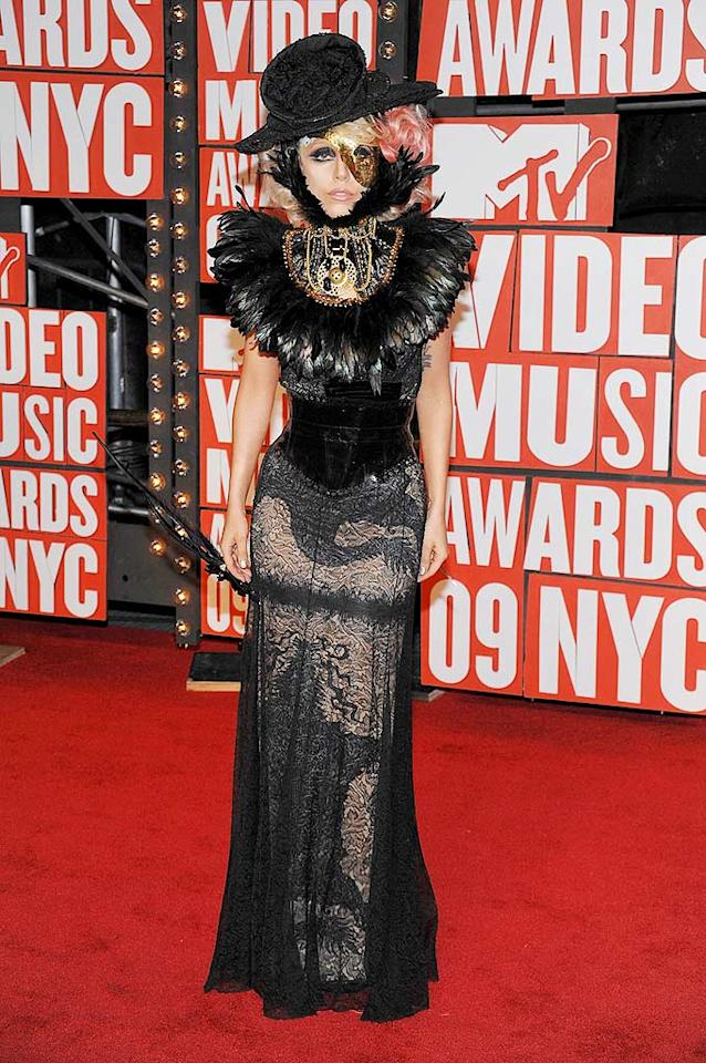 """Lady Gaga  Grade: A+  For her sheer originality, willingness to take incredible fashion risks, and that insane ensemble consisting of a feathered Jean-Paul Gaultier frock, bedazzled neck brace, and gold mask, Lady Gaga undoubtedly earned one of the night's highest marks. Dimitrios Kambouris/<a href=""""http://www.wireimage.com"""" target=""""new"""">WireImage.com</a> - September 13, 2009"""