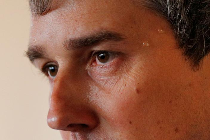 Sweat beads on the temple of Democratic presidential candidate and former Rep. Beto O'Rourke as he speaks during a campaign stop at Popovers Bakery and Cafe in Portsmouth, N.H., on Thursday. (Brian Snyder/Reuters)
