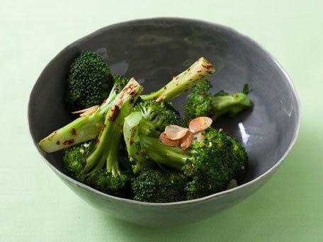 """<strong>Get the <a href=""""http://www.huffingtonpost.com/2011/10/27/sizzled-garlic-broccoli_n_1057116.html"""">Sizzled Garlic Broccoli</a> recipe</strong>"""