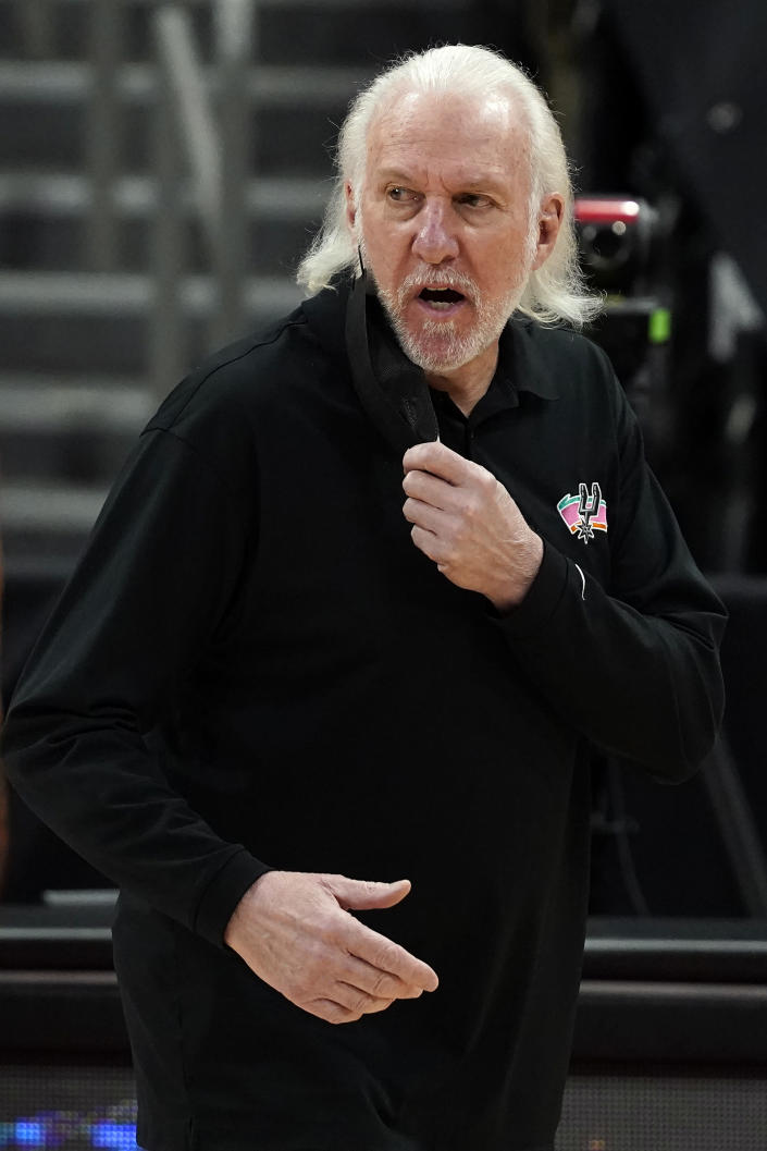 San Antonio Spurs head coach Gregg Popovich talks to an official during the second half of an NBA basketball game against the Toronto Raptors Wednesday, April 14, 2021, in Tampa, Fla. (AP Photo/Chris O'Meara)