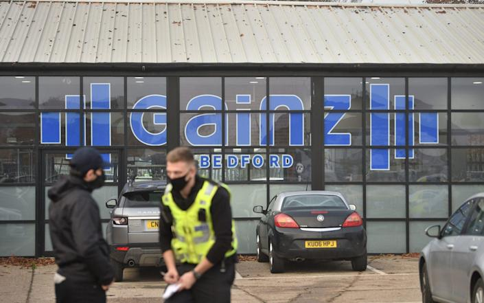 Police outside Gainz Health and Fitness in Bedford - Joe Giddens/PA