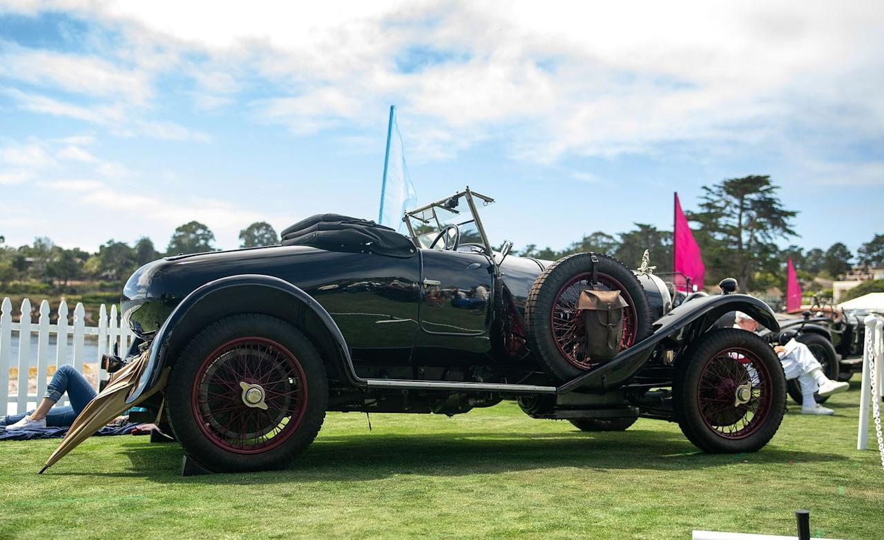 <p>This year, Pebble Beach was chockablock with Bentleys from the '20s and '30s in a nod to the brand's centenary. These old-school Bentleys tend to be big, truckish, dark-green-painted things. This 1925 model is a little more distinct. Its red radiator badge indicates it was the Speed model (one of only 513), meaning it has a high-compression engine and a close-ratio gearbox. Its two-seat Park Ward bodywork also distinguishes it, and it has perhaps the world's silliest and most charming hood ornament. If you're expecting a sleek bird or a shapely lady for this car's ornament, forget it. A potbellied Punch character stands atop the radiator holding a wrench and a crankshaft.<em>–Daniel Pund</em></p>