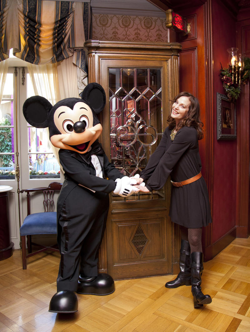 "ANAHEIM, CA - DECEMBER 29: Oscar-nominated actress Lesley Ann Warren poses with Mickey Mouse beside an ornate phone booth adapted from the Disney film, ""The Happiest Millionaire"", inside Club 33 at Disneyland park on December 29, 2011 in Anaheim, California. Warren made her big screen debut in the 1967 film, which was also Walt DisneyÕs final live action movie project. (Photo by Paul Hiffmeyer/Disney Parks via Getty Images)"