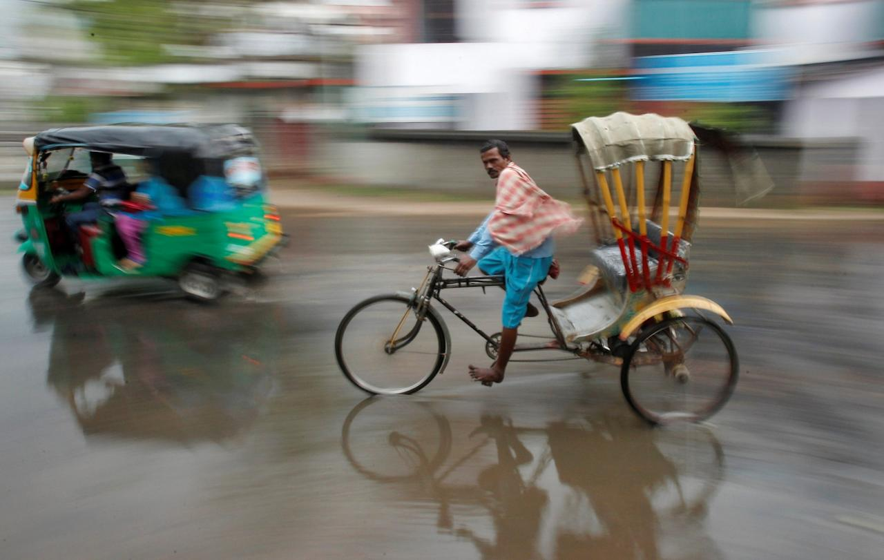 <p>A man pedals his cycle rickshaw during rains in Agartala, India, March 18, 2017. REUTERS/Jayanta Dey </p>