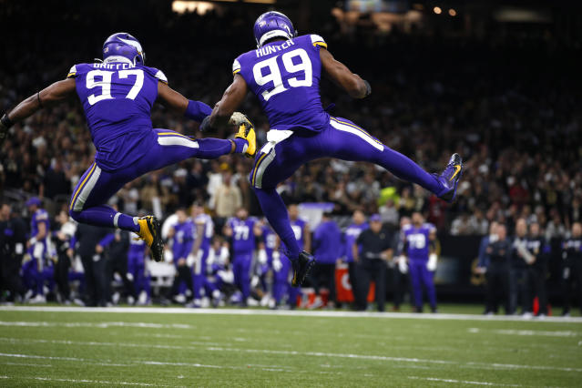 Minnesota Vikings defensive end Everson Griffen (97) and Minnesota Vikings defensive end Danielle Hunter (99) celebrate a sack in the first half of an NFL wild-card playoff football game against the New Orleans Saints, Sunday, Jan. 5, 2020, in New Orleans. (AP Photo/Butch Dill)