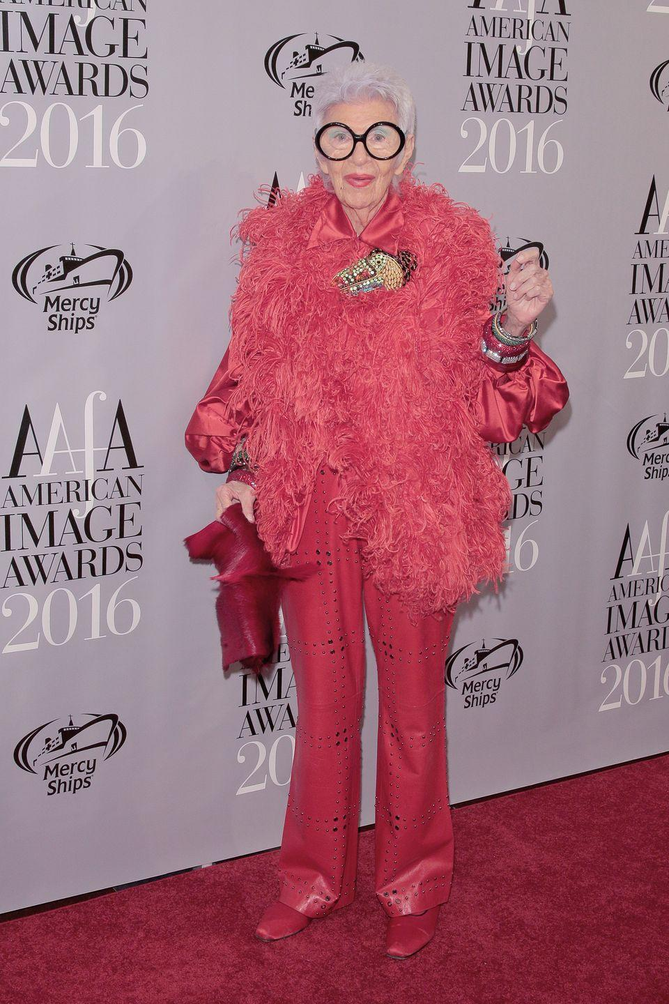 <p>Here, the lady in pink: Iris Apfel is wearing cut-out pink leather and a perfectly matching blouse, loafers, and fur coat.<br></p>