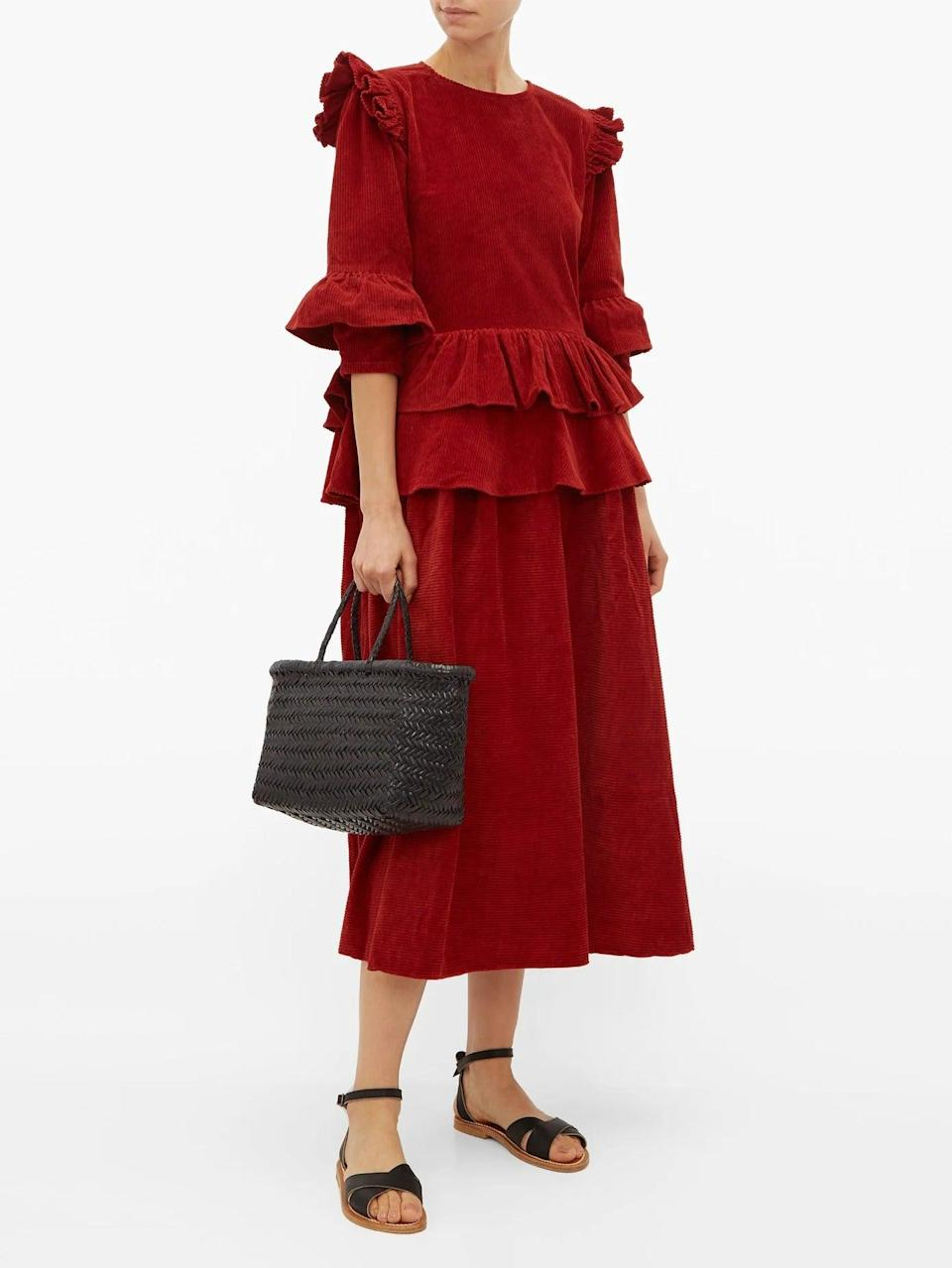 """<br><br><strong>Story MFG</strong> Tulsi Ruffled Cotton Corduroy Midi Dress, $, available at <a href=""""https://www.matchesfashion.com/products/Story-MFG-Tulsi-ruffled-cotton-corduroy-midi-dress-1308069"""" rel=""""nofollow noopener"""" target=""""_blank"""" data-ylk=""""slk:MatchesFashion.com"""" class=""""link rapid-noclick-resp"""">MatchesFashion.com</a>"""