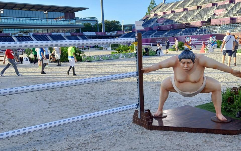 A sumo wrestler-themed fence at the showjumping - JIM WHITE