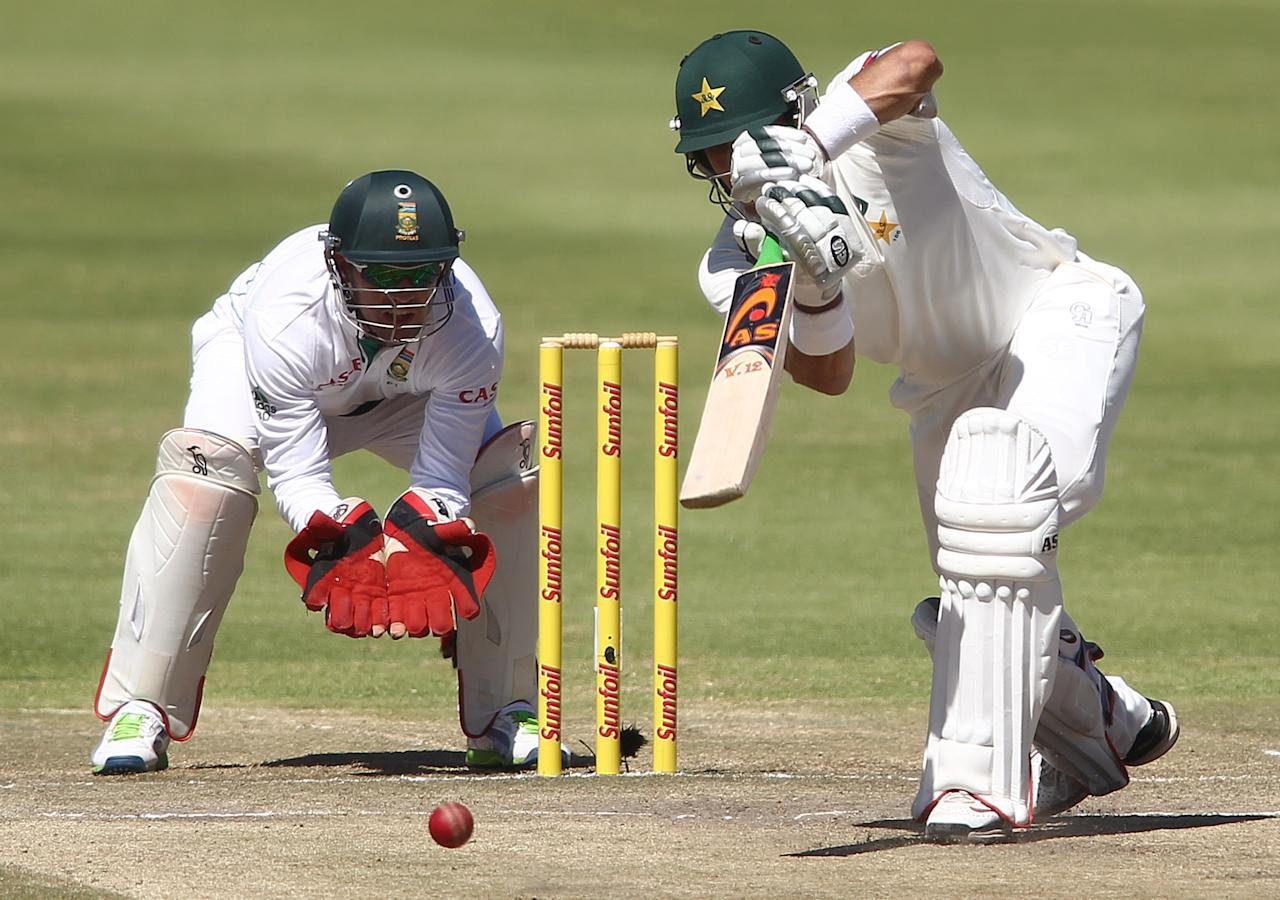 CAPE TOWN, SOUTH AFRICA - FEBRUARY 17:  Pakistan captain Misbah-ul-Haq drives a delivery during day 4 of the 2nd Sunfoil Test match between South Africa and Pakistan at Sahara Park Newlands on February 17, 2013 in Cape Town, South Africa. (Photo by Shaun Roy/Gallo Images/Getty Images)