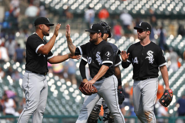 Chicago White Sox's Jose Abreu, from left, Luis Avilan and Matt Davidson celebrate their 6-5 win against the Detroit Tigers after a baseball game in Detroit, Wednesday, Aug. 15, 2018. (AP Photo/Paul Sancya)