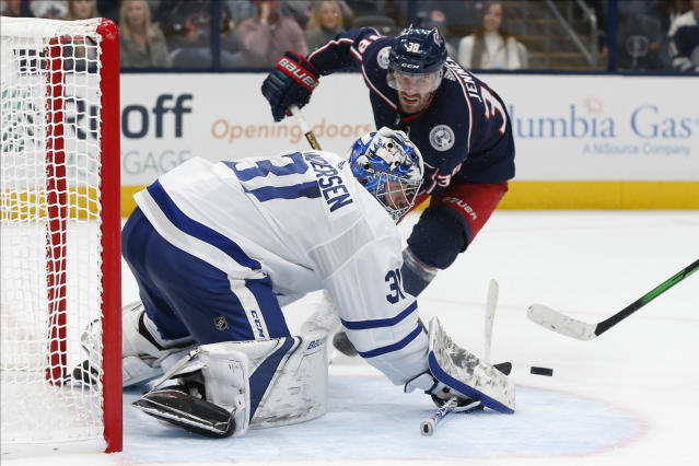 Toronto Maple Leafs' Frederik Andersen, front, of Denmark, makes a save against Columbus Blue Jackets' Boone Jenner during the second period of an NHL hockey game Friday, Oct. 4, 2019, in Columbus, Ohio. (AP Photo/Jay LaPrete)