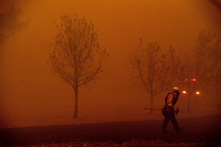A firefighter battles a wildfire called the Kincade Fire in Healdsburg, Calif., Sunday, Oct. 27, 2019. With ferocious winds driving multiple wildfires through bone-dry vegetation and nearly 200,000 people ordered to leave their homes, California's governor declared a statewide emergency Sunday. (Photo: Noah Berger/AP)