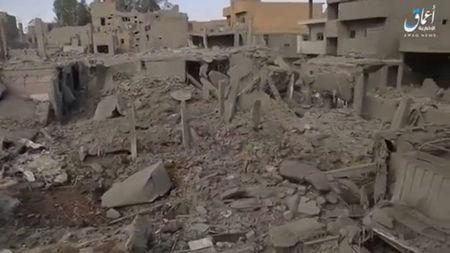 A still image taken from a video released on the internet by Islamic State-affiliated Amaq News Agency, on April 18, 2017, purports to show the aftermath, said to be in al-Bukamal town, in Deir al-Zor province