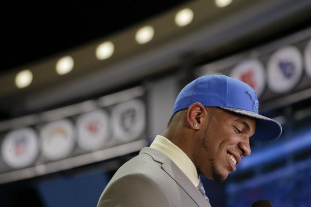 North Carolina tight end Eric Ebron walks off the stage after being selected by the Detroit Lions as the 10th pick in the first round of the 2014 NFL Draft, Thursday, May 8, 2014, in New York. (AP Photo/Craig Ruttle)