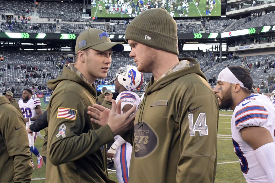 FILE - In this Sunday, Nov. 11, 2018, file photo, Buffalo Bills quarterback Josh Allen, left, and New York Jets quarterback Sam Darnold (14) talk after an NFL football game in East Rutherford, N.J. Allen and Darnold, if healthy, are set to square off in a matchup of first-round picks on Sunday, when the Bills  host the Jets. (AP Photo/Bill Kostroun, File)