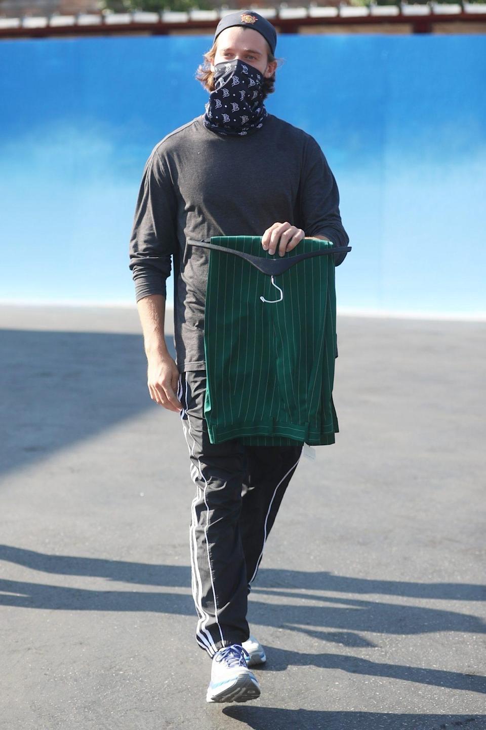 <p>Patrick Schwarzenegger goes for a walk with friends after picking up a pair of pants in West Hollywood on Tuesday. </p>