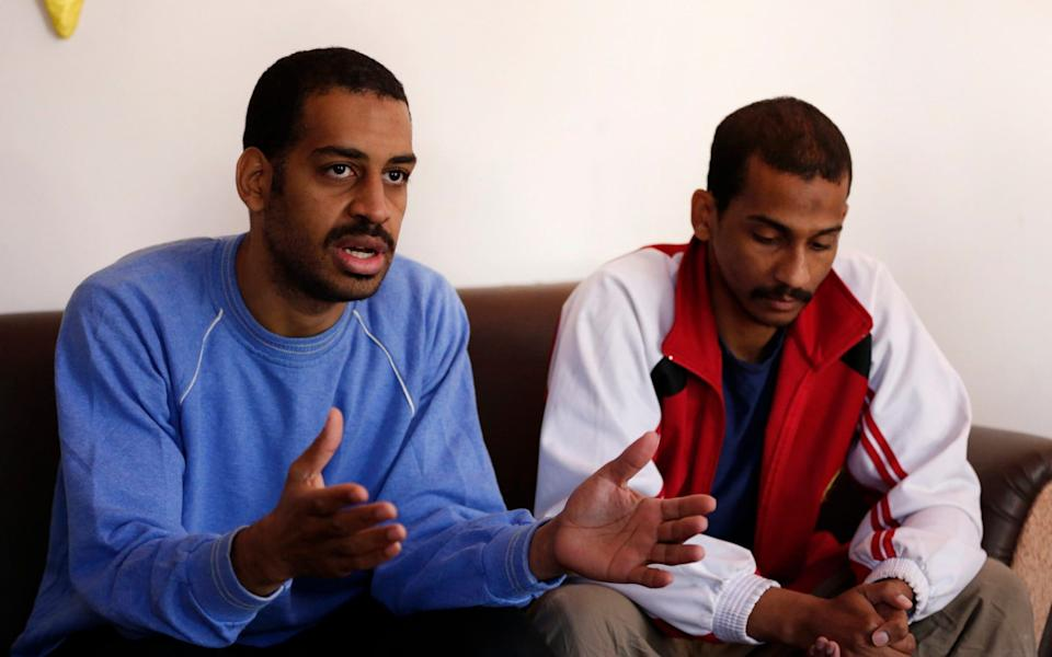 In this March 30, 2019, file photo, Alexanda Amon Kotey, left, and El Shafee Elsheikh, speak during an interview at a security center in Kobani, Syria - AP
