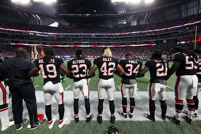 <p>Atlanta Falcons players lock arms during the national anthem before their game against the Buffalo Bills at Mercedes-Benz Stadium. Mandatory Credit: Jason Getz-USA TODAY Sports </p>