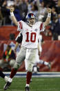 FILE - In this Feb. 3, 2008, file photo, New York Giants quarterback Eli Manning (10) celebrates after his 13-yard touchdown pass to Plaxico Burress in the fourth quarter of the Super Bowl XLII football game against the New England Patriots at University of Phoenix Stadium in Glendale, Ariz. Eli Manning's long and distinguished reign as the New York Giants' starting quarterback is seemingly over. Let the Daniel Jones era begin. Coach Pat Shurmur announced Tuesday, Sept. 17, 2019, that the No. 6 overall pick in the NFL draft is replacing two-time Super Bowl MVP as the Giants' quarterback, beginning Sunday at Tampa Bay.(AP Photo/Julie Jacobson, File)