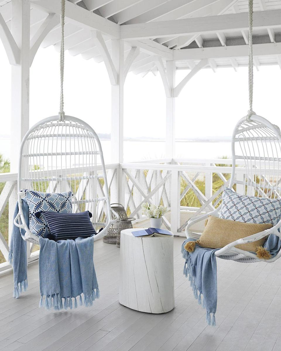 "<p>Take your seating up a notch–literally–with hanging chairs. These white ones from <a href=""https://www.serenaandlily.com/outdoor-hanging-chair/white/237821.html?utm_campaign=pjgeneric&publisherId=120661&clickId=3177757246&utm_source=pj&utm_medium=affiliate"" rel=""nofollow noopener"" target=""_blank"" data-ylk=""slk:Serena & Lily"" class=""link rapid-noclick-resp"">Serena & Lily</a> (inspired by Scandinavian design) offer an airy, sculptural frame that keeps the space feeling unconfined.</p>"