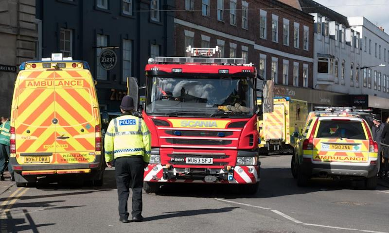 Police officers direct a fire engine outside the Zizzi restaurant in Salisbury.