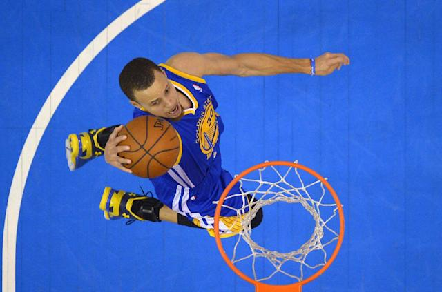 Golden State Warriors guard Stephen Curry goes up for a shot during the second half in Game 7 of an opening-round NBA basketball playoff series against the Los Angeles Clippers, Sunday, May 4, 2014, in Los Angeles. The Clippers won 126-121. (AP Photo/Mark J. Terrill)