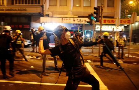 Anti-extradition demonstrators throw rocks, after a march to call for democratic reforms in Hong Kong