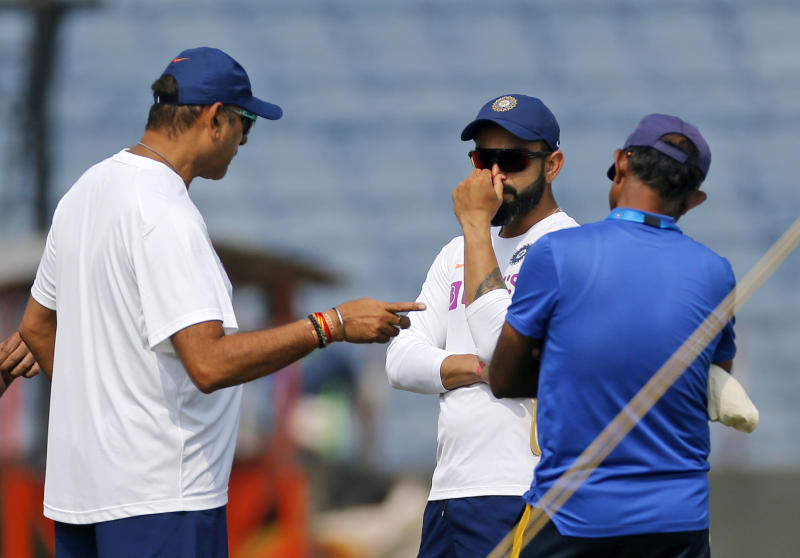 Indian cricket team captain Virat Kohli listens to coach Ravi Shastri during a practice session ahead of the second test match between India and South Africa in Pune, India, Wednesday, Oct. 9, 2019. (AP Photo/Rajanish Kakade)
